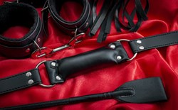 Crop gag cuffs on red background