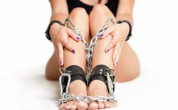 Woman in bondage cuffs