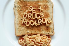 Alphabet noodles spelling sex drugs rock and roll on toast