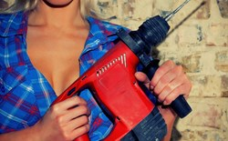 Sexy woman holding a power tool