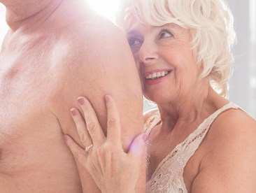 Two older adults being intimate