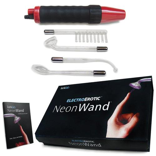 electrostimulation toy neon wand with box and all the components laid out