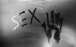 Steamy mirror with sex and handprint
