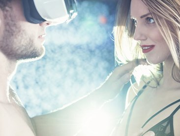 Man with VR goggles exploring virtual woman
