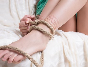 Woman with bondage rope