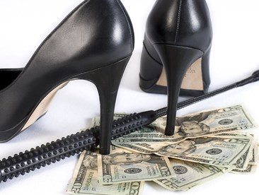 Why do some Dommes charge for their services?
