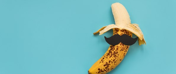 cock rings: A partly peeled banana with a moustache is pictured against a light blue background