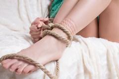 Woman with bondage rope