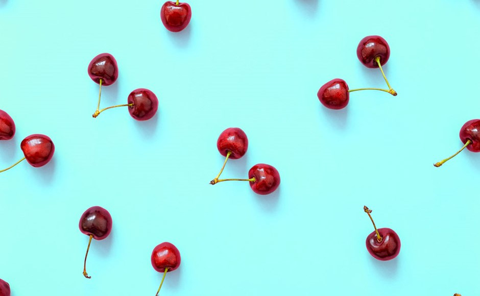 Cherries close up on blue background