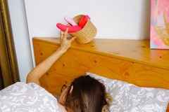 What is chronic masturbation- a person reaches out of their bed for a sex toy