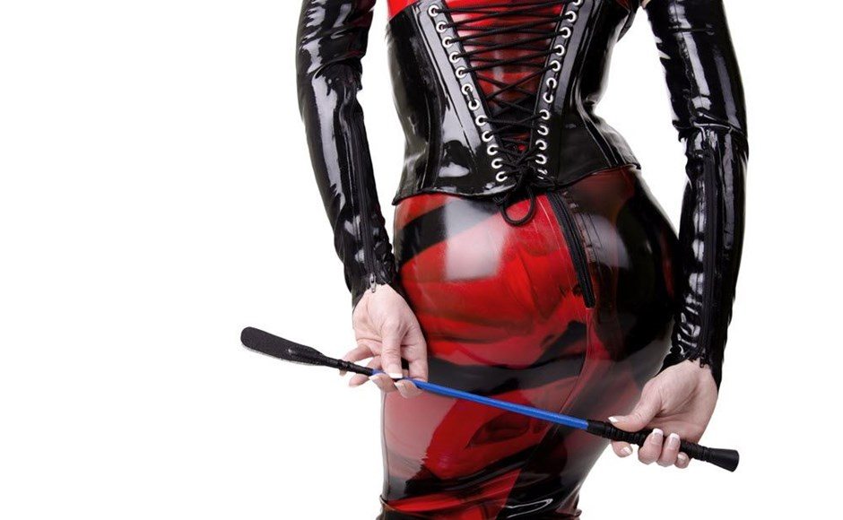 Dominatrix holding a crop