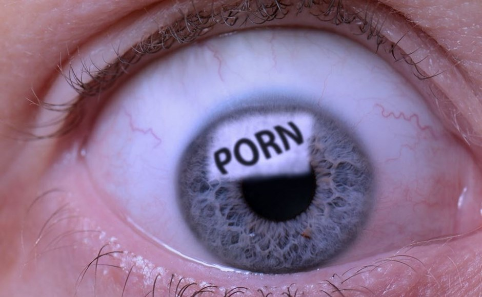 Close up of an eye reflecting pornography