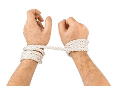 Hands tied in rope bondage