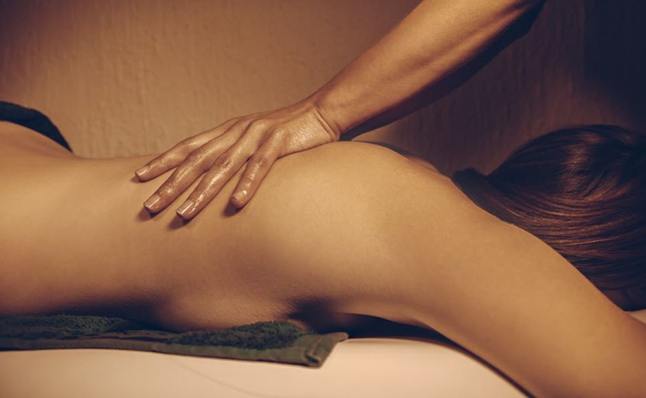 Woman receiving erotic massage