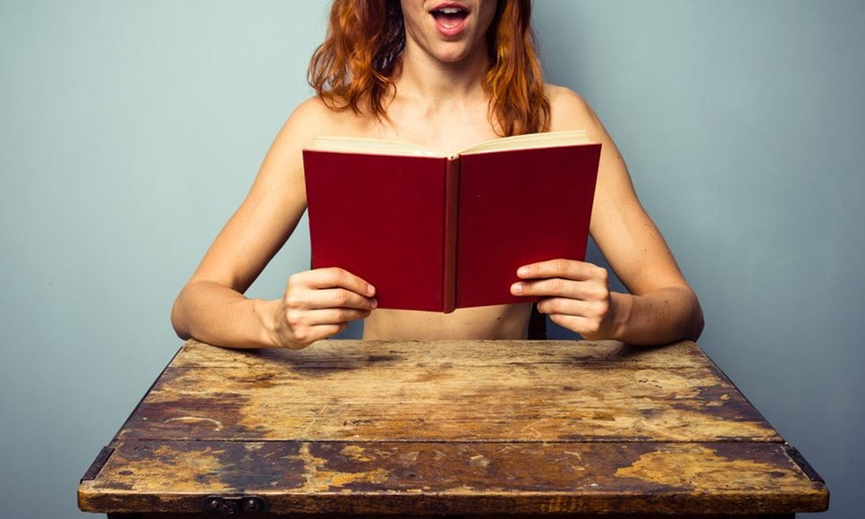 Woman reading erotic book