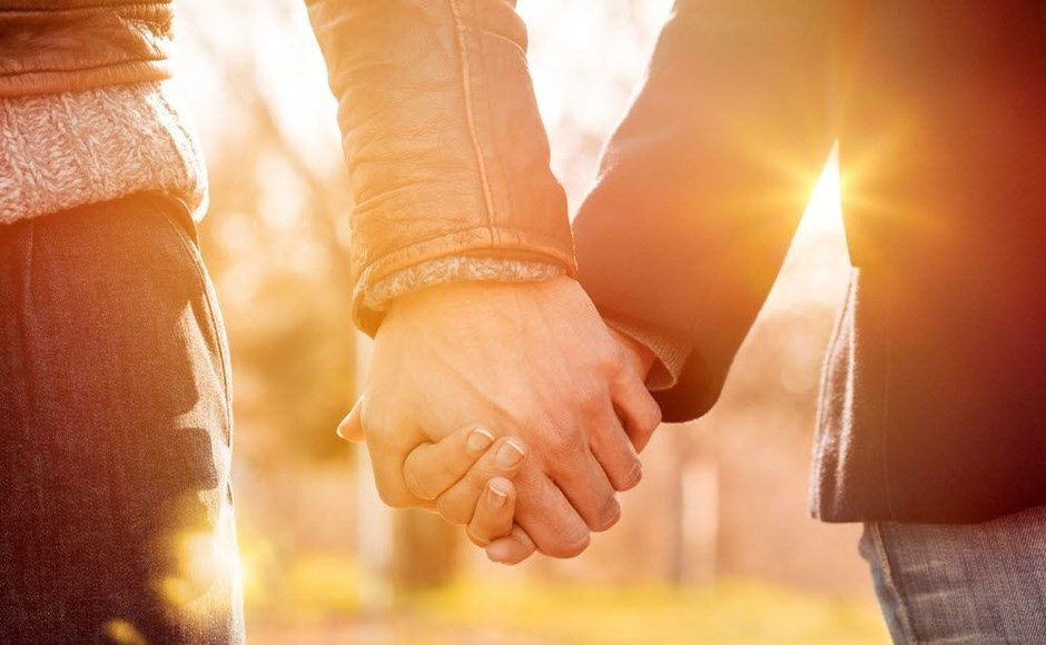 Monogamous couple holding hands