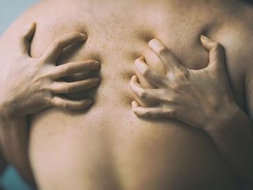 Hands grabbing their partner's back
