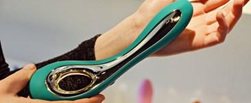 woman holding beautiful modern vibrator