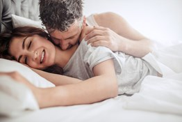 Sexy couple in bed happy