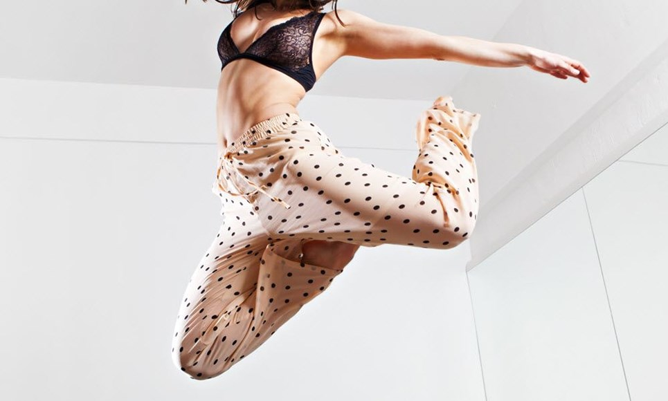 Sexy woman in pajamas jumping