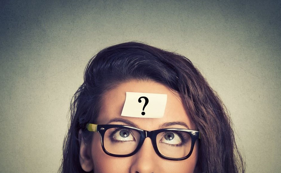 Woman with question mark on her forehead