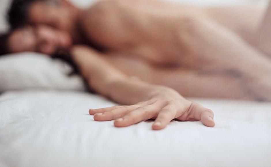 woman reaching vibrator