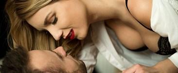 Couple enjoying foreplay and sex