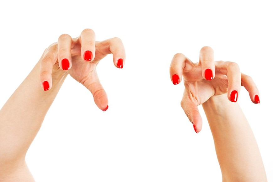 women's hands held in claws like an animal