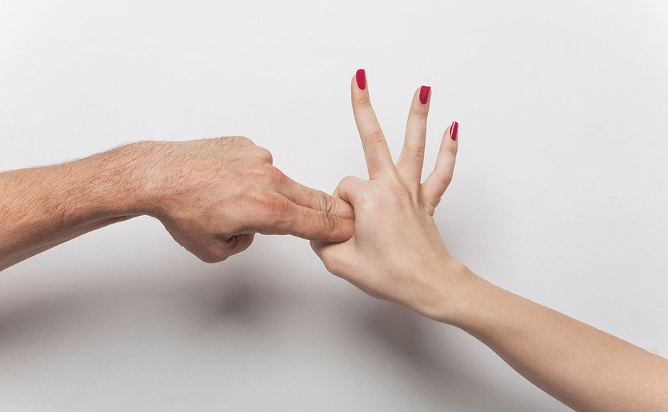 hands showing anal sex