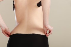 woman undressing from behind