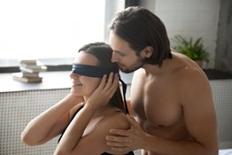 I want to make my blindfolded submissive partner feel like there's a third person in the room. Any suggestions?