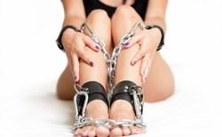 Woman in bondage cuffs
