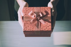 5 Reasons Why Your Partner Just Bought You a Sex Toy, a pretty gift wrapped box is shown
