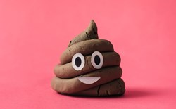 a cartoon poop on a pink background
