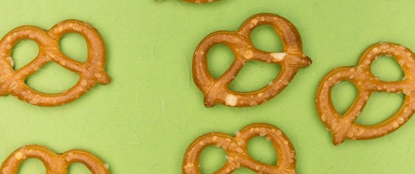 best flexible sex positions: several pretzels against a green background are shown
