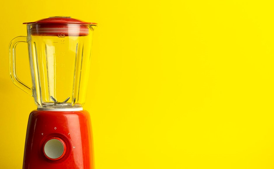 Red blender on a yellow background