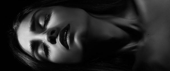 sensual aroused woman in dark monochrome