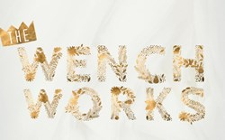 The Wench Works written in gold glitter