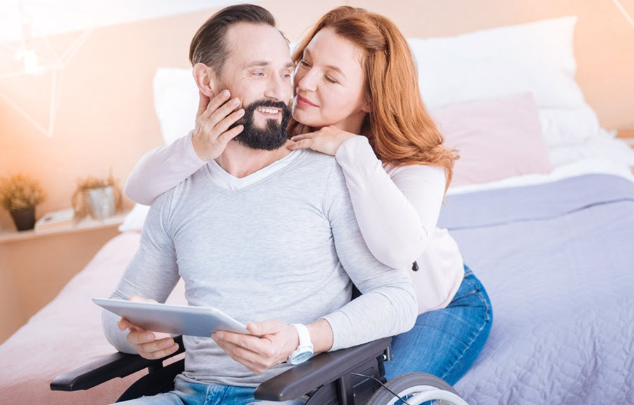Intimate couple with wheelchair